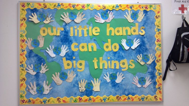 """The title of this bulletin board, """"Our Little Hands Can Do Big Things"""" is a creative title for an Earth Day bulletin board display."""