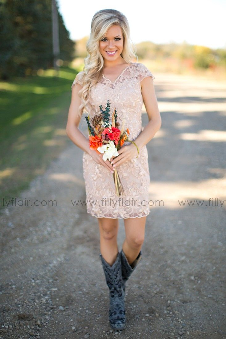 Gorgeous bridesmaid dress with boots for a country wedding!