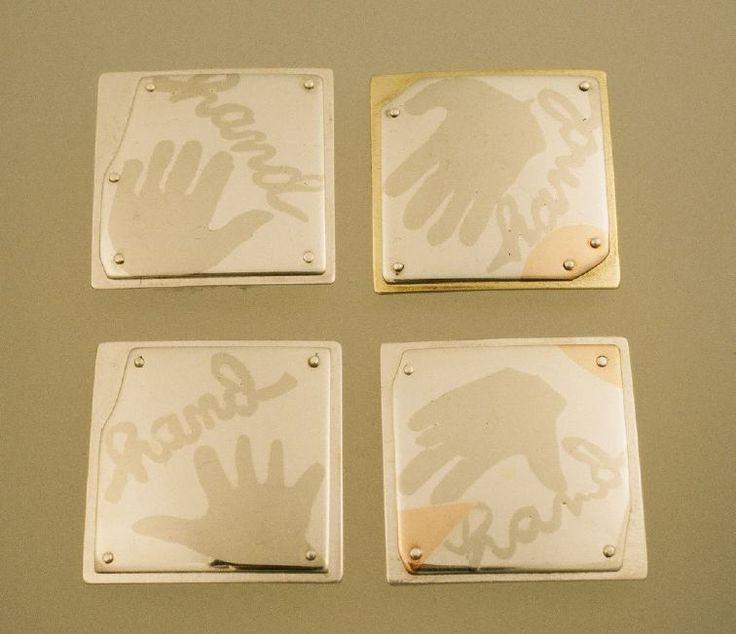 4 Pins: Multi-metal Lamination: sterling, nickel, copper.