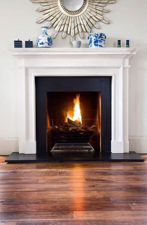 Love the simplicity of this...simple and cozy. Add Aquamarine fire glass crystals for extra elegance thd.co/16CEHLv #homeimprovement #interiordesign #fireplace