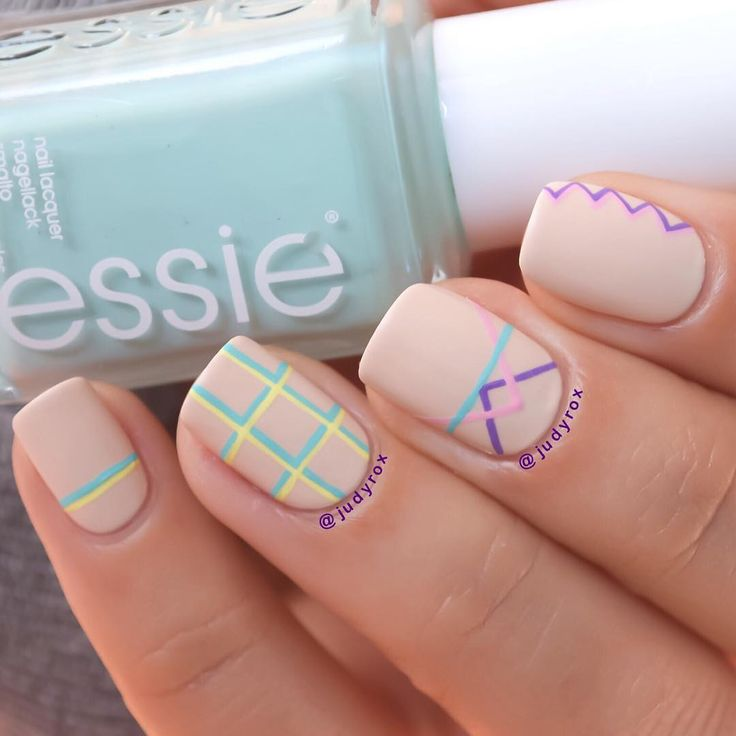 Detailed geometric nail art by @judyrox