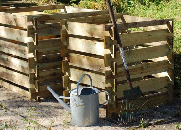 The compost box is a traditional style composter made from pressure-treated FSC wooden slats.
