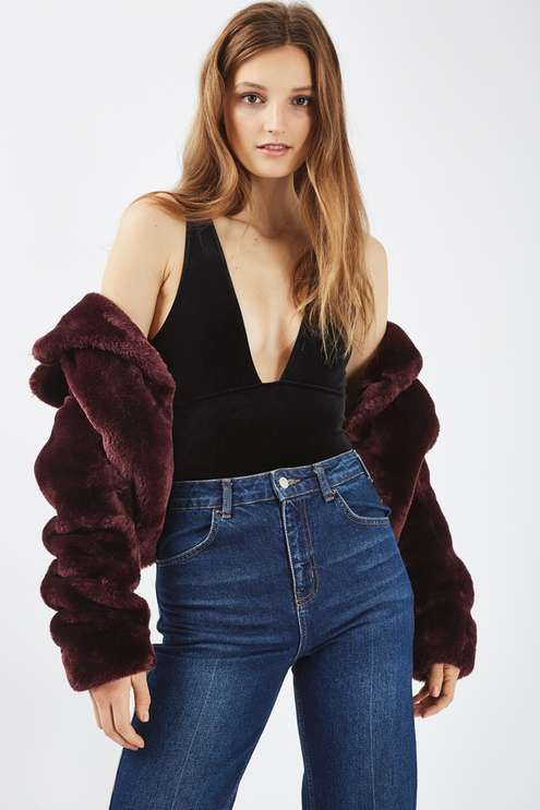 Dress things up after dark in this velvet body with a plunging neckline. A perfect party piece, team with a pair of high waisted jeans and a luxe fur coat for a guaranteed head-turning look. #Topshop