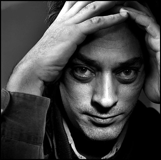 Paul Benjamin Auster (born February 3, 1947) is an American author known for works blending absurdism, existentialism, crime fiction, and the search for identity and personal meaning in works such as The New York Trilogy (1987), Moon Palace (1989), The Music of Chance (1990), Timbuktu (1999),The Book of Illusions (2002), and The Brooklyn Follies (2005).