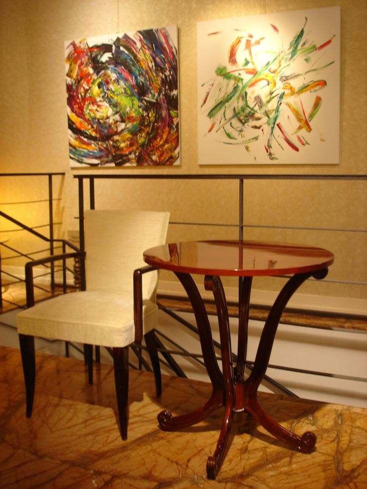 Art Deco coffee table and bridge chair with modern paintings