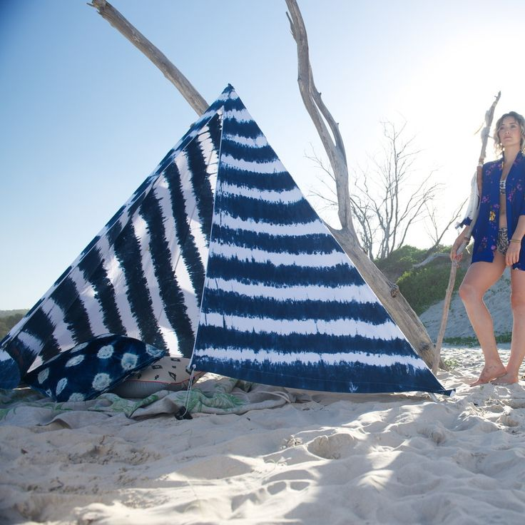 Due to popular demand there is a wait on this item, please currently allow 3-4 weeks. We may be able to direct you towards a stockist in your area if you contact us.Original tipi style beach tent designed in Byron Bay Australia. Indigo dyed and made individually by hand in Bali. Breathable rayon provide sun protection that stays cool on the beach. Machine washable. Your package comes in a matching bag that is lightweight and easy to carry. More compact than a beach umbre...