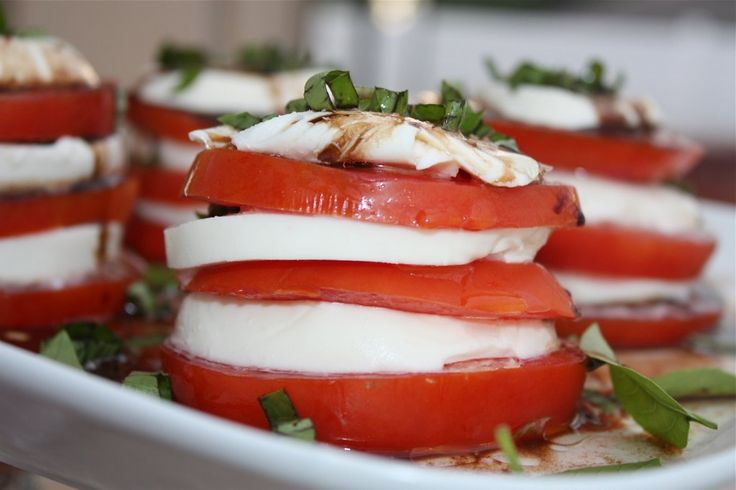 Tomato, mozzarella, and basil stacks