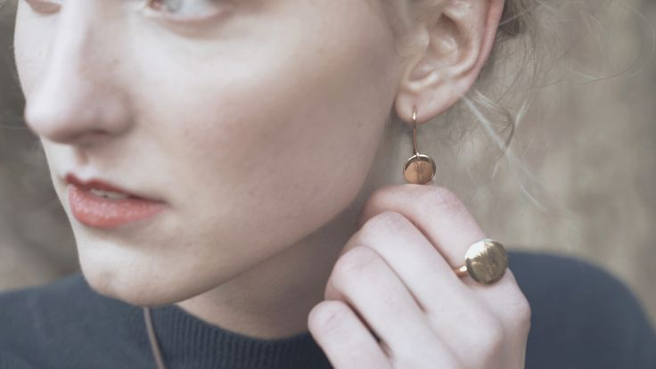 Hargreaves Stockholm - AW17 Campaign images. Bracteate Fairmined gold signet ring worn with Bracteate Fairmined gold drop earrings both laser engraved with the Hargreaves hare.