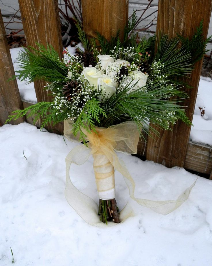 White Flowers And Christmas Greens With Pine Cones And