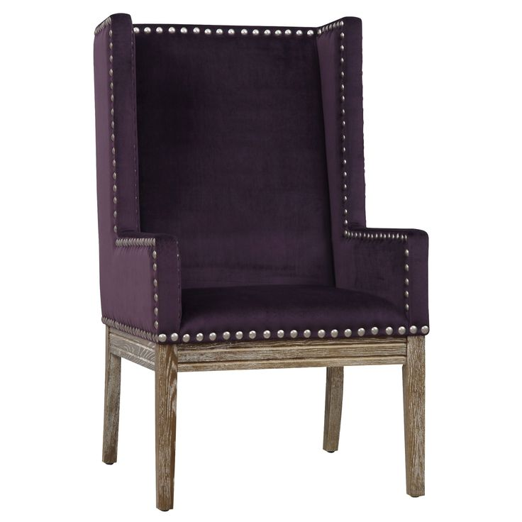 This elegant chair features a silver nail head trim. They can be used as a dining or accent chair in any room.