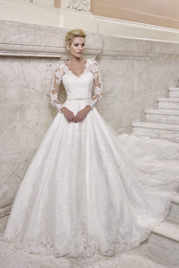 Blonde Hair In A Low Updo Marble Staircase Lace Wedding Dress With Cap Sleeves V Neckline Wedding Dresses Uk Long Sleeve Wedding Dress Lace Ellis Bridal