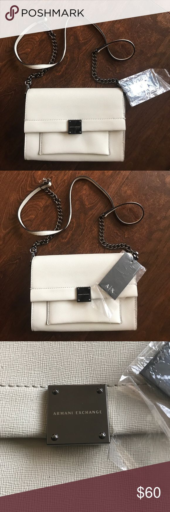 Armani Exchange Crossbody Bag with tags and box Very cute Crossbody Bag With Armani Exchange logo in the front . . Has snap button closure. Inside the flap there is a small pocket too . Armani Exchange Bags Crossbody Bags