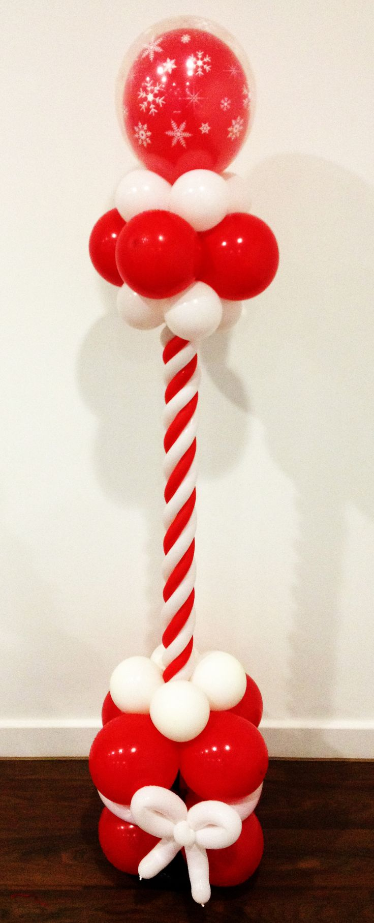 A Christmas Candy Cane inspired Balloon Column