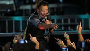 Bruce Springsteen  packs his concerts to bursting, and still it wasn't enough Friday in the first of two sold-out shows at  Wrigley Field . There were 28 songs, 18 musicians and singers in the newly expanded E Street Band, and guest shots from  Pearl Jam 's Eddie Vedder and Rage Against the Machine's Tom Morello.