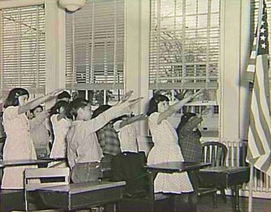 From 1892 to 1942, people pledged allegiance to the flag with the Bellamy salute (invented by the author of the pledge of allegiance). Worried that it might be confused with the Nazi's Roman salute, Congress changed the salute to simply placing a hand over the heart. - Take me on a trip a long, long time ago!