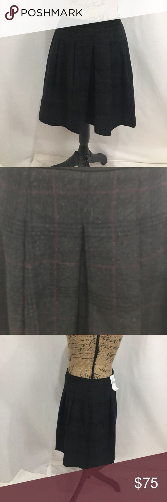 Ann Taylor LOFT wool plaid pleated skirt Grey and maroon plaid. Pleated mini skirt. Lined. Size 2. Materials as pictured. Back zipper. Measurements are approx in inches. W-15 h-free length-18.   🌹no trades 🌹discounts on bundles of 2+  🌹1000 items listed, take a peak!  🌹suggested user, posh compliant: LOFT Skirts