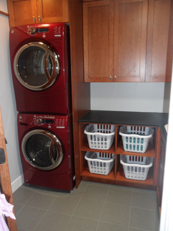 This looks like what we'll be working with.  I'd like it to hold 2 baskets in the bottom section, as well as detergent.  At the top, instead of a cabinet, I'd like short drawers converted to drying racks.