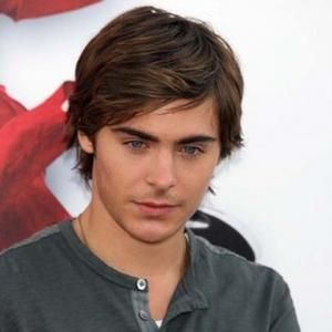 My male lead, Travis Quincy, could be portrayed nicely by Zac Efron... as long as he's willing to dye his hair black :)