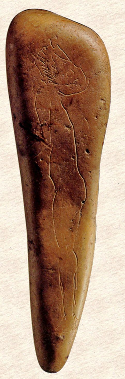 Paleolithic Human Profile Engraved on a Pebble  --  Circa 15,000-17,000  years old  --  Excavated from la Madeleine Cave, France.