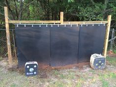My arrow backstop that I finally finished! I started off with a 4x4 frame about 14 feet wide and 6 feet across. I used lead pipe and small fence clamps to hang three horse stall mats. Then just in case I ran the cable through the pipe pulled tension and mounted them to rings for extra support. Definitely a 2 or 3 man job but it's wide enough for my family of 4 to each person to set up a target. Now I'm just going to put up some lights so I can practice when I get home from work!