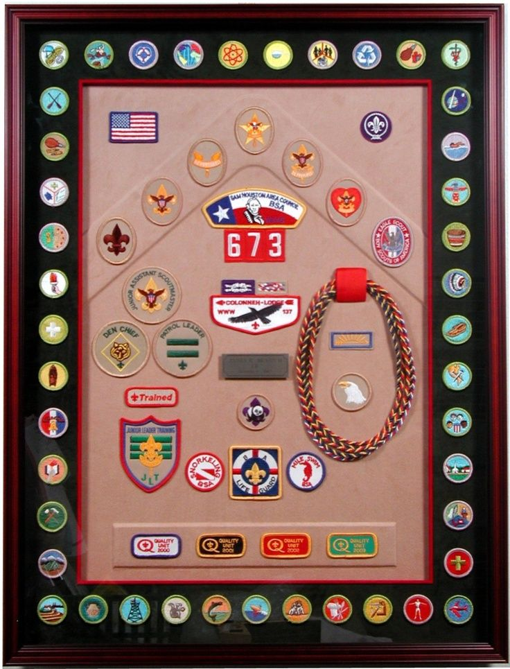 framed boy scout award;  merit badges around the edges with rank and other awards and positions inside