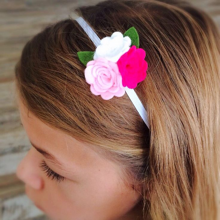 Pretty rolled rose on a non-slip headband https://butterflygardenforkids.com.au/collections/clothing-to-love/products/triple-rose-headband