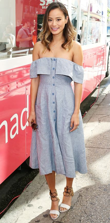 Jamie Chung kept cool in the summer heat, stopping by the Sally Beauty Mobile Nail Studio in a breezy off-the-shoulder Reformation shirt dress with ankle-tie Loeffler Randall sandals.