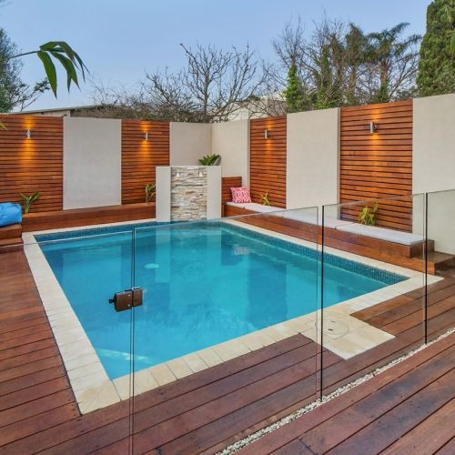 Glass Pool Fencing Systems | Everton (but I really Love the Concrete and Horizontal Slat fencing beyond)