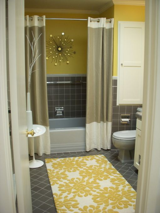 Mid-Century Yellow and Gray Bathroom with two shower curtains. super cute idea as long as the floor doesn't flood after every shower...
