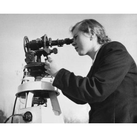 Young woman looking through an astronomical telescope Canvas Art - (24 x 36)