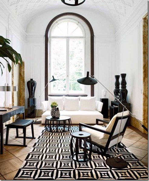 window trimmed in black - gives definition and weight to the wall  So many all white rooms could benefit by accenting SOMETHING in the space...