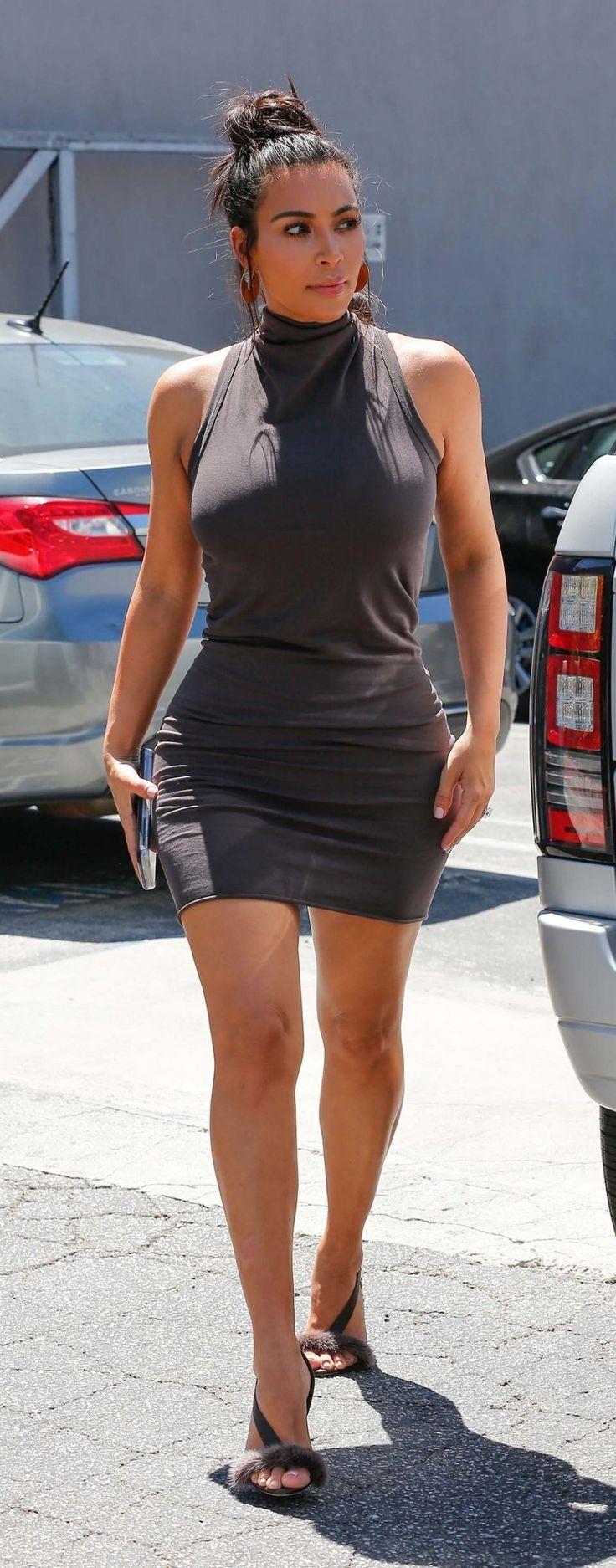 Kim Kardashian West in a body-con mini-dress and fur-trimmed heels from Olgana Paris.