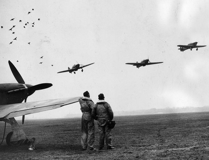 """Sgt František Chábera (left) and Sgt Ladislav """"Larry"""" Světlík watch a flight of No 312 Squadron RAF getting airborne from RAF Speke in November 1940. The squadron's first victory was a Ju 88 shared by P/O Alois Vašátko, F/L Denys E """"Kill 'em"""" Gillam and Sgt Josef Stehlík above Liverpool on 8 October."""