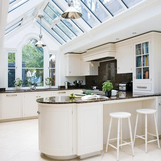 Gabled conservatory extension: Here, a linking conservatory joins an outbuilding to the main property, via a light and airy kitchen. A gable window provides a focal point in this design.