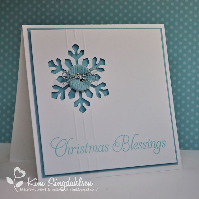 handmade Christmas card ... simply beautiful ... white with touches of medium blue ... negative die cut snowflake with a button ....score lines ... simple greeting ...