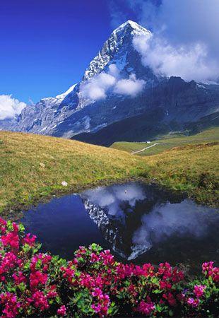 North face of the Eiger reflected in lake, Switzerland (© Günter Gräfenhain/Huber/4Corners Images)