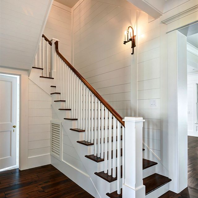 First floor stair landing robyn hogan home design custom wall sconce walnut wide plank for Home designer stairs with landing