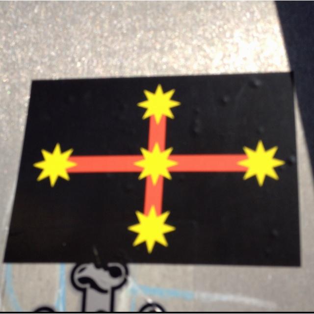 Aboriginal eureka flag (sticker on a street sign on Moncur st)