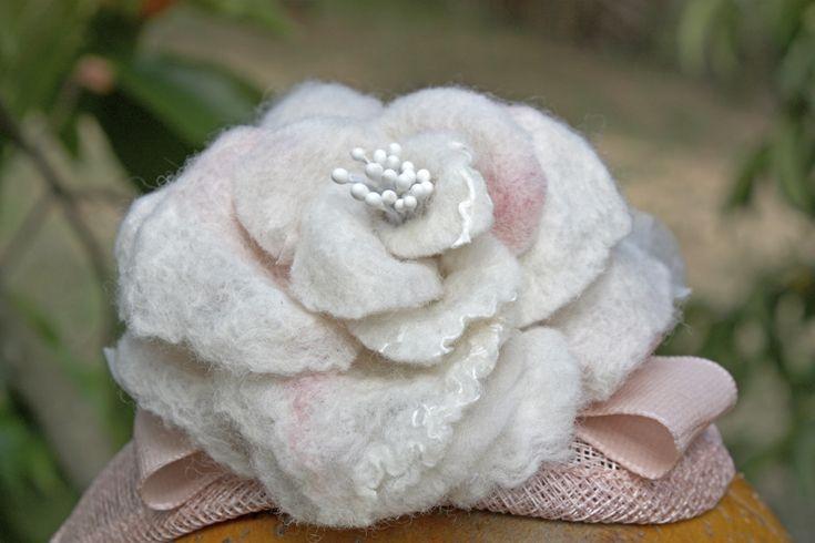 Headdress: Sinamay, silk fiber, lace and merino wool.