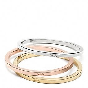 Mixed metal bangle set from Coach, this is a must have. Gonna save up, these will match anything!