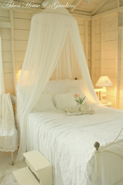 Sweet dreams in this cozy cottage bedroom.