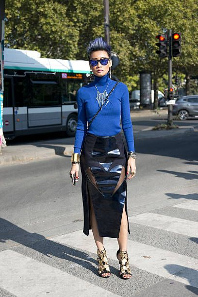 Fashion Editor at The Rake Esther Quek wears a Harry Halim skirt Giuseppe Zanotti shoes Oakly sunglasses and Uniqlo top on day 6 during Paris Fashion...