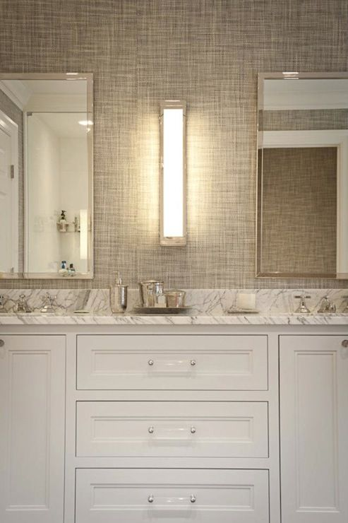 installed by JCS Construction - lucite hardware, white marble countertops, gray grasscloth backsplash, Visual Comfort Lighting Mercer Long Box Sconces in Polished Nickel, polished nickel mirrors