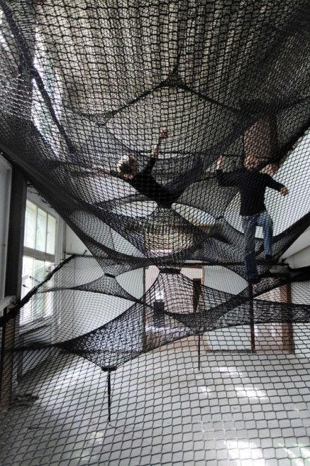 Net Z33! This would be just as fun as having a slide or swing inside.  Really cool if it had a trapeze swing bar.
