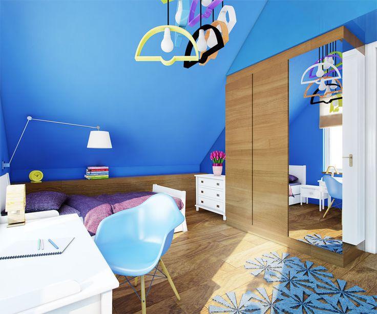 Wystrój pokoju dziecięcego w niebieskich barwach. Słoneczny pokój na poddaszu ocieplony został drewnianą dębową podłogą i meblami.