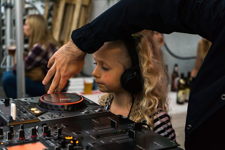 I went to take some pictures at a local concert and I saw a DJ stand nearby where there was this little girl with headphones. Her dad was showing her how to DJ, and she seemd very much into it.