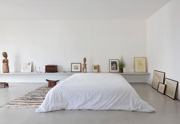 Minimal and arty bedroom in an open space of San Paolo, Brazil