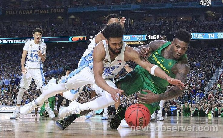 North Carolina's Joel Berry II (2) and Oregon's Jordan Bell (1) go after the ball during UNC's 77-76 victory over Oregon in NCAA Division I Men's Basketball Championship national semifinals at the University of Phoenix Stadium in Glendale, AZ, Saturday, April 1, 2017.