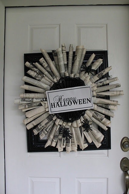 Halloween wreath made out of newspaper.