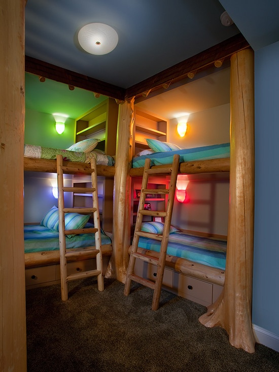 multiple kids bedroom create a functional alcove and place floor to ceiling bookshelves behind bunk beds give kids the option to choose their own